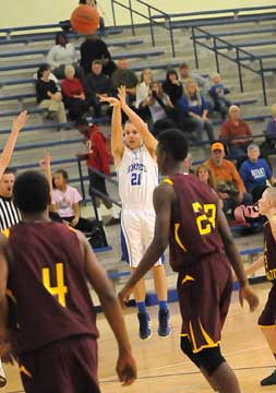 John Winn (21) launches a buzzer-beating 3 to end the first quarter. (Photo by Kevin Nagle)