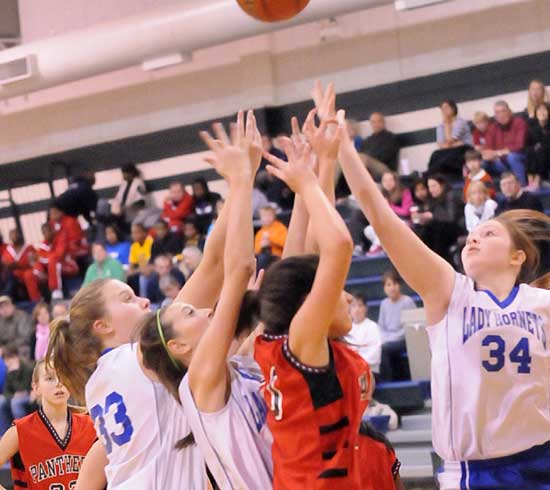 Anna Turpin (33), Kailey Nagle and Annie Patton (34) battle for a rebound. (Photo by Kevin Nagle)