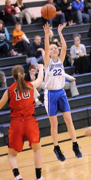 Brittney Sahlmann launches a jumper. (Photo by Kevin Nagle)