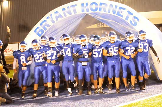 Bryant seniors take the field arm in arm Thursday night. (Photo by Kevin Nagle)