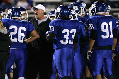 Bryant defensive coordinator Steve Griffith gives his group instruction during a timeout. (Photo by Rick Nation)