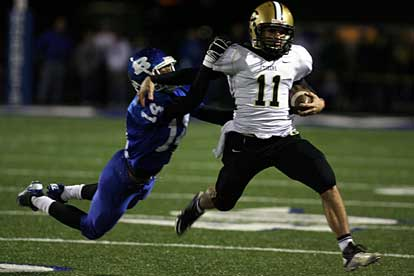 Bryant's Chris Stephens (14) makes a bid to bring down Central's Hayden Wynne. (Photo by Rick Nation)