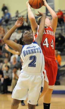 Vilonia's Jessica Brandon (44) goes up over Bryant's Jayla Anderson (2) for a rebound. (Photo by Kevin Nagle)