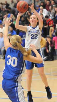Bryant Blue's Britney Sahlmann (22) fires a shot over Bryant White's Julianna Ward (30). (Photo by Kevin Nagle)