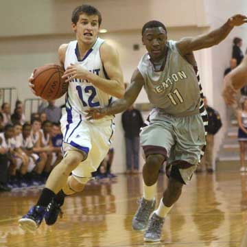 Bryant's Brantley Cozart (12) starts to drive past Benton's Ricky Gipson. (Photo by Rick Nation)