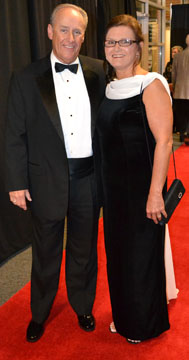 Dean and Barbara Riggin of Iberia Bank stop for a photo on the red carpet at the Starlight Gala at Bishop Park. (PHOTO BY Shontel Stott)