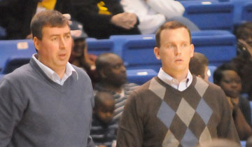 Bryant assistant coach Steve Wilson, left, and head coach Mike Abrahamson watch the action. (Photo by Kevin Nagle)