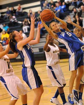 Anna Lowery (5) goes up for a shot. (Photo by Kevin Nagle)