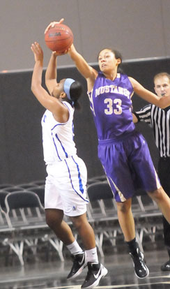 CAC's freshman Syndie Jones (33) blocks a shot by Bryant's Dez Duckworth. (Photo by Kevin Nagle)