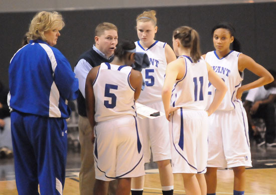 Bryant coaches Monica Parish, left, and Brad Matthews give instructions to Dezerea Duckworth (5), Haley Murphy (45), Logan Davis (11) and Kiara Moore (20) during a timeout Thursday. (Photo by Kevin Nagle)