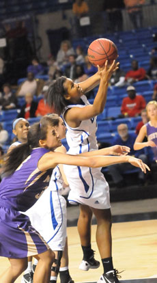 Taneasha Rhode grabs a rebound. (Photo by Kevin Nagle)