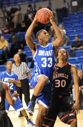 Bryant's Leon Neale (33) goes up for a shot in front of teammate Marcus Wilson (22). (Photo by Kevin Nagle)