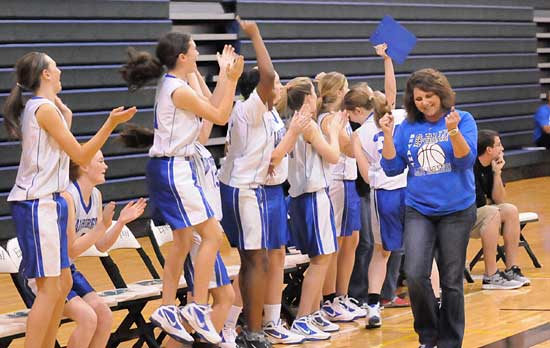 Head coach Rhonda Hall and the Bryant Blue bench celebrate a key play in Saturday's championship game. (Photo by Kevin Nagle)