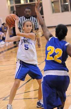 Anna Lowery (5) looks to get a pass past an E-Stem defender. (Photo by Kevin Nagle)