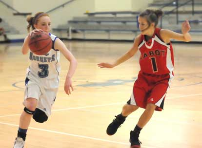 Nikki Clay tries to drive past Cabot South's Danielle McWilliams. (Photo by Kevin Nagle)