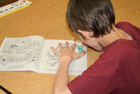 Brian Curtis, a student at Bethel Middle School, enjoys his recycling coloring book provided by the Saline County Regional Solid Waste Management District.  The SCRSWMD handed out approximately 8,000 recycling coloring books to Saline County students to promote recycling education on Nov. 17-18.