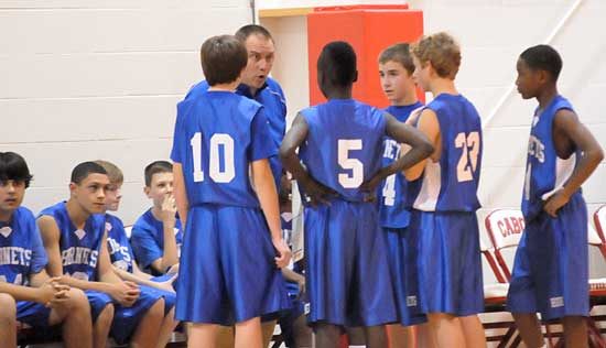 Bryant Blue coach Derek McGrew instructs his players during a timeout Tuesday night. (Photo by Kevin Nagle)