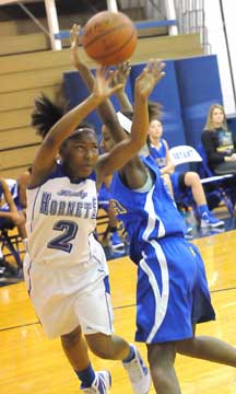 Jayla Anderson fires a shot around a North Little Rock defender. (Photo by Kevin Nagle)