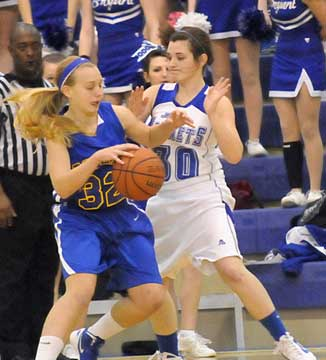 Bryant's Mallory Curry (30) applies some defensive pressure. (Photo by Kevin Nagle)