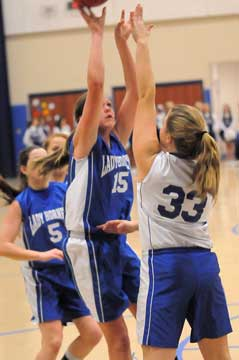 Bryant White's Lara White (15) shoots over Bryant Blue's Anna Turpin (33). (Photo by Kevin Nagle)