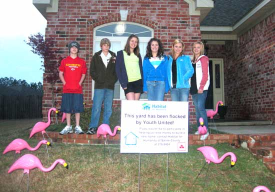 """Youth United members Trent Williams; Spencer Smith; Haven Betts;  Sarah Smith; Carlie Taylor and Madalyn Toler """"flamingoed"""" a Bryant residence."""