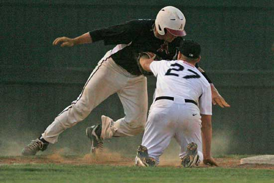 Bryant's Tyler Brown tags out Levi Saxby on a pickoff play at third. (PHoto by Rick Nation)