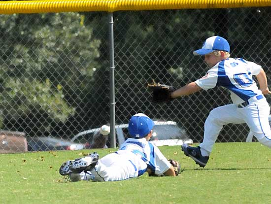 Matthew Griffe and Grant Johnson chase a gapper during Sunday's game. (Photo by Kevin Nagle)