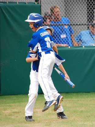 Logan Chambers celebrates after scoring the tying run in the sixth.