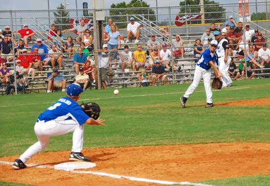 Pitcher Logan Grant throws to Nathan McFarland at first for an out during Saturday's game.