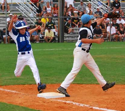 Ryan Lessenberry stretches to try to beat a throw to first.
