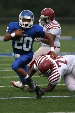 Bryant's Jalen Bell breaks a tackle. (Photo by Rick Nation)