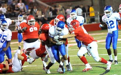 Karon Dismuke powers through tacklers. (Photo by Kevin Nagle)