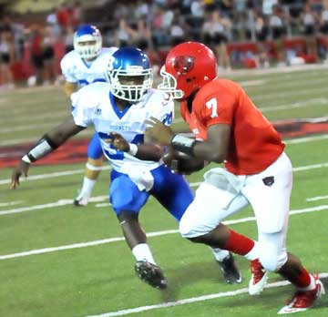 Walter Dunn (34) closes in on Northside's quarterback Kenrick Burns (7). (Photo by Kevin Nagle)