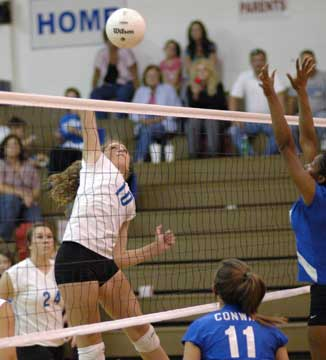 Alyssa Anderson leaps high for a spike. (Photo by Kevin Nagle)