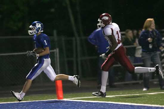 Sawyer Nichols (1) reaches the end zone ahead of a Texarkana defender. (Photo by Rick Nation)