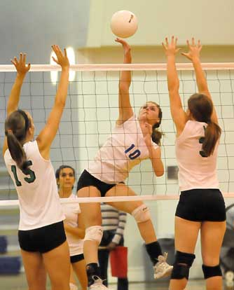 Bryant's Alyssa Anderson (10) sends a spike over the Van Buren defense. (Photo by Kevin Nagle)