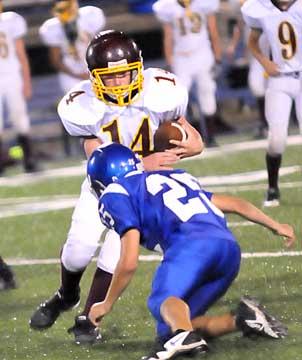 Houston Chavis (25) hits the Lake Hamilton quarterback. (Photo by Kevin Nagle)