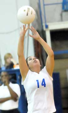 Carley Choate sets for a teammate. (Photo by Kevin Nagle)