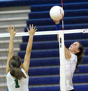 Kaylon Wilson, right, spikes the ball over a Van Buren blocker. (Photo by Kevin Nagle)