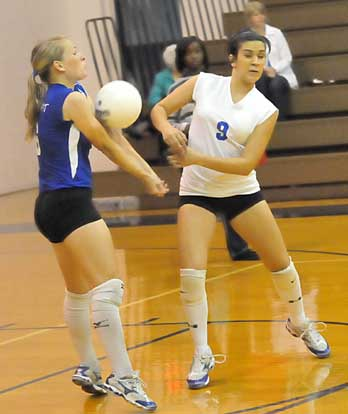 Bryant libero Lauren Reed, left, and Rochelle Aguilar (9). (Photo by Kevin Nagle)
