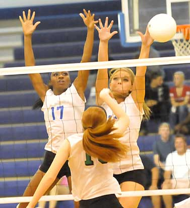 Brianna White and Hannah Rice reach for a block. (Photo by Kevin Nagle)