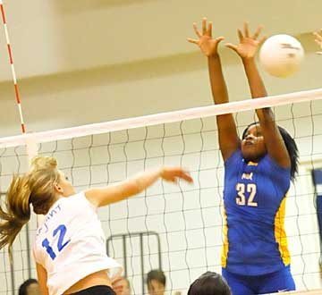 McKenzie Rice, left, makes a bid for one of her 18 kills. (Photo by Kevin Nagle)