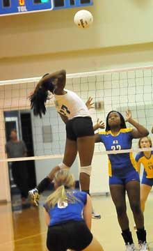 Brianna White (17) skies on an attack. (Photo by Kevin Nagle)