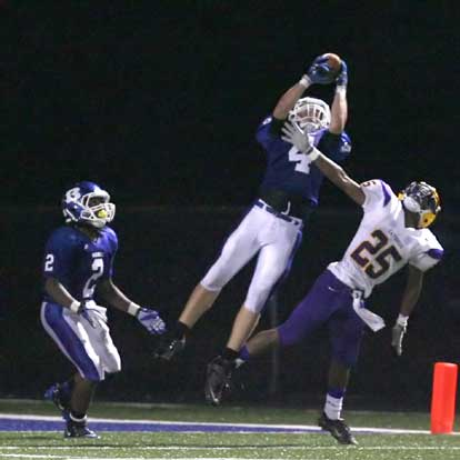 Bryant's Jesse Johnson (4) goes high to nearly intercept the final pass of the night. (Photo by Rick Nation)