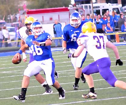 Hayden Lessenberry (16) delivers under pressure. (Photo by Kevin Nagle)
