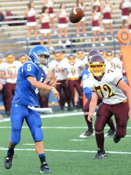 Bryant's Brandon Warner gets a throw away before Lake Hamilton's D.J. Everhart arrives. (Photo by Kevin Nagle)
