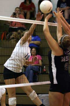Alyssa Anderson (10) spikes one over the Mount St. Mary blockers. (Photo by Rick Nation)