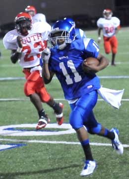 Mar'Kevius Nelson (11) runs past Cabot South's Brian Marshall on his way to the end zone. (Photo by Kevin Nagle)