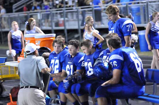 Offensive line coach Kirk Bock talks with Andrew McBride (72), Tanner Neal (61), Zack McConnell (76), Caleb Chaffin (66) and Jimbo Seale (71). (Photo by Kevin Nagle)