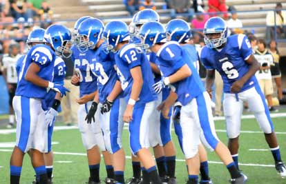Brendan Young (33) gives his teammates the defensive call prior to a play Thursday night. (Photo by Kevin Nagle)